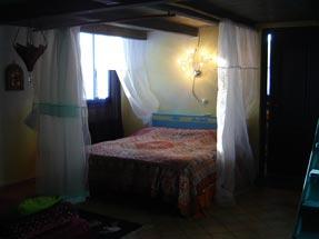 The blue suite main bed - La dolce vita lipari.